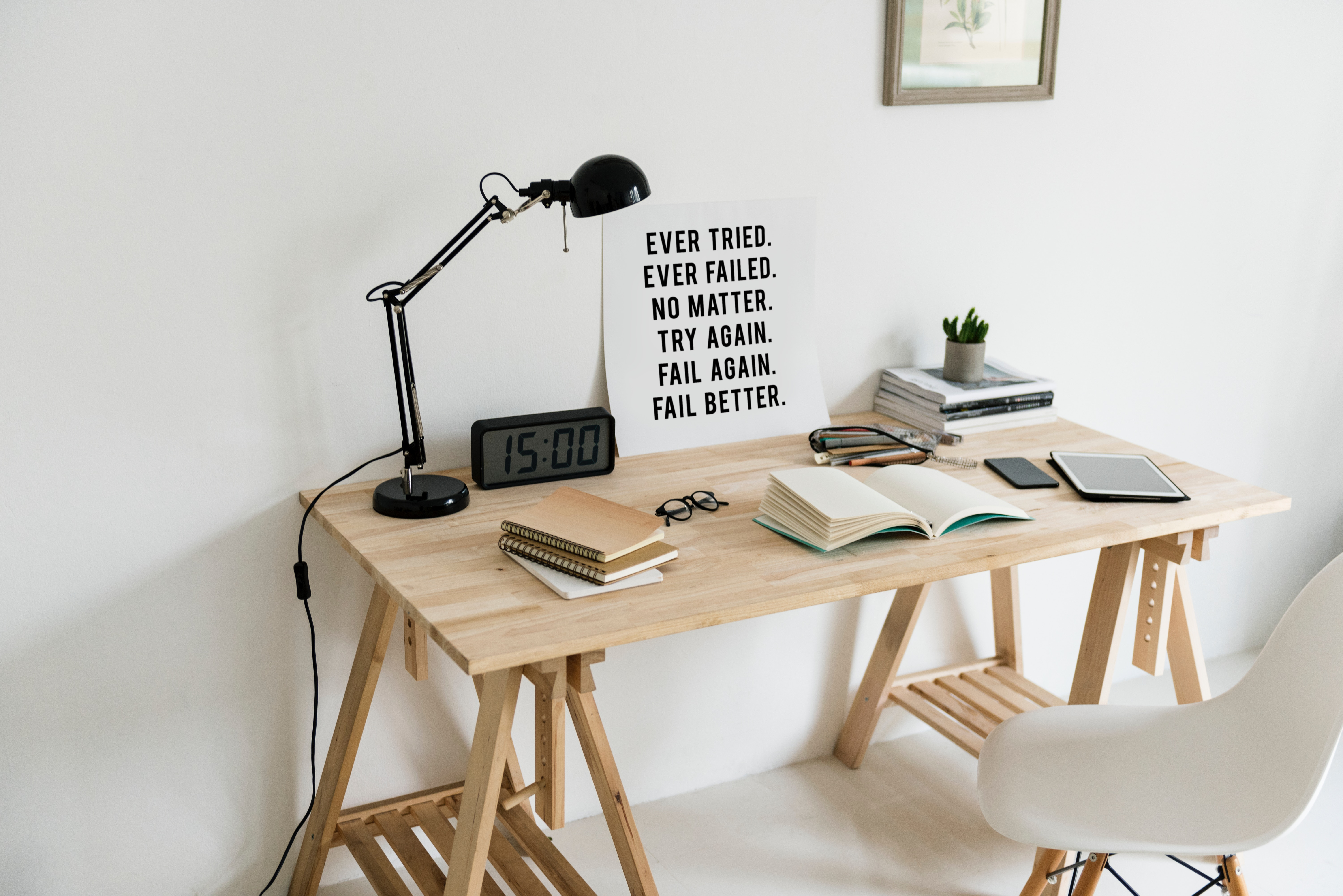 Writing desk with books and picture